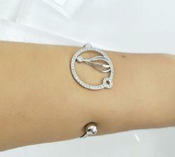 Bracelete redondo vazado com zirconias cravajadas