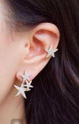 Ear clip = Piercing fake  formato estrela pedras micro zircônias transparente cravejada  folheado a ouro.