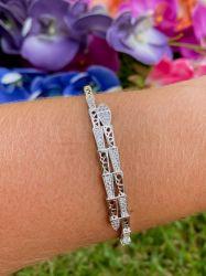 Bracelete cobra vazado detalhes em micro zircônias transparente